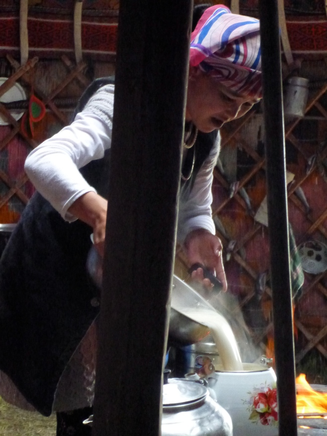The wife of one of the sons prepares milk tea.