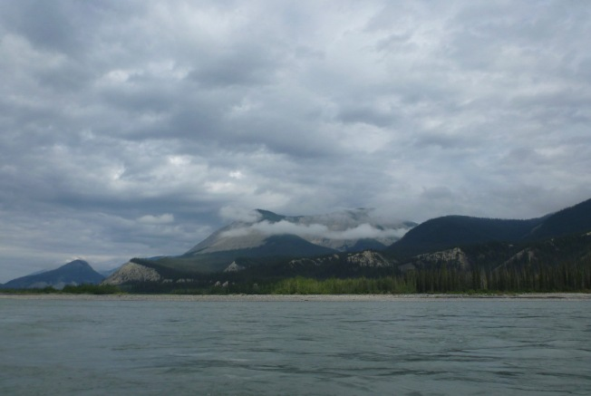 The Nahanni is wide here and the sky big.